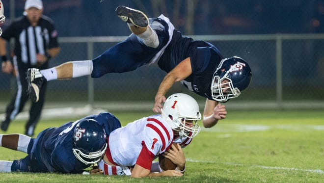Nicholas Picard and Dillon Borel sack the Eagles quarterback Taylor Blanchard as Lafayette Christian Academy takes on Central Catholic. Friday, Sept. 28, 2018.