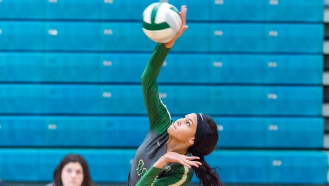 Amaya Crutcher hitting as Acadiana takes on Destrahan in the first round of the LHSAA Volleyball Playoffs. Thursday, Nov. 1, 2018.