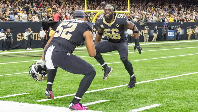 Saints linebackers Craig Robertson (52) and Demario Davis (56) celebrate during Sunday's game against the Pittsburgh Steelers in New Orleans.