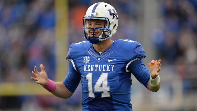 UK QB Patrick Towles celebrates after a touchdown pass during the second half of the University of Kentucky Wildcats Football game against Louisiana-Monroe in Lexington, KY. Saturday, October 11, 2014.