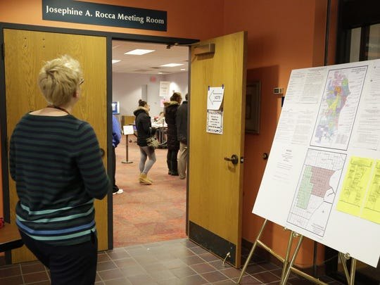 A woman enters Mead Library's polling place Tuesday April 5, 2016 in Sheboygan.