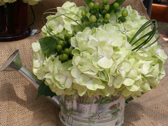 Floral Watering Can with Hydrangea and Berries  $49.jpg