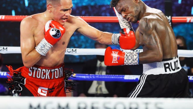 Stockton' Gabe Flores Jr. lands a left hand against Honduras' Josec Ruiz in their lightweight fight on Thursday in Las Vegas. Flores won by unanimous decision to improve to 18-0.