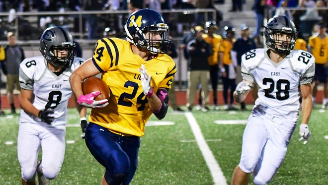 South Lyon's Will Kelly (with ball) and South Lyon East's Jacob Koshko (right) were named to the All-Lakes Valley Football Team.