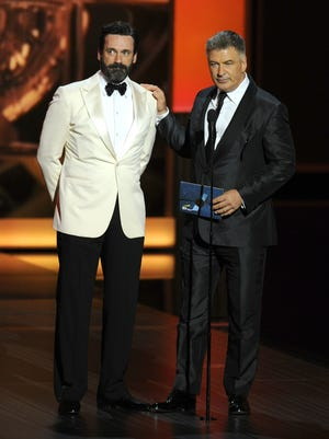 Jon Hamm, left, and Alec Baldwin present the award for outstanding lead actress in a comedy series on stage at the 65th Primetime Emmy Awards at Nokia Theater on Sept. 22, 2013, in Los Angeles.