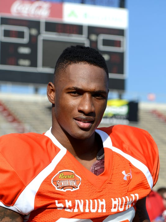 Damarious Randall, Arizona State University defensive back, works with North Team players on the first day of practice