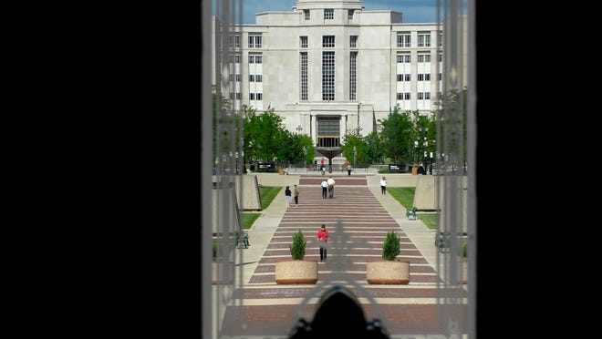 In this 2007 State Journal file photo, state workers and others walk on the pedestrian mall between the Hall of Justice and the Capitol building. An ever-rising number of state employees are approaching retirement age.