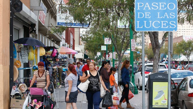 The county and city might team up to hire a company to conduct a study on the economic impact in El Paso of Mexican shoppers. Here, shoppers from Juárez make their way back home along El Paso Street after completing their shopping in Downtown El Paso.
