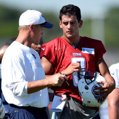 Titans head coach Ken Whisenhunt talks with quarterback