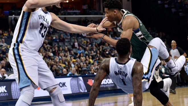 Milwaukee Bucks forward Giannis Antetokounmpo, top right, collides with Memphis Grizzlies forward Jarell Martin (1) and center Marc Gasol (33) in the first half of an NBA basketball game Monday, March 12, 2018, in Memphis, Tenn. (AP Photo/Brandon Dill)
