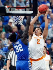 Tennessee forward Grant Williams (2) shoots against Kentucky's Wenyen Gabriel (32) during the second half of an NCAA college basketball championship game at the Southeastern Conference tournament Sunday, March 11, 2018, in St. Louis. (AP Photo/Jeff Roberson)
