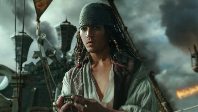 """In this image released by Disney, Anthony De La Torre portrays a young Jack Sparrow in a scene from """"Pirates of the Caribbean: Dead Men Tell No Tales."""""""