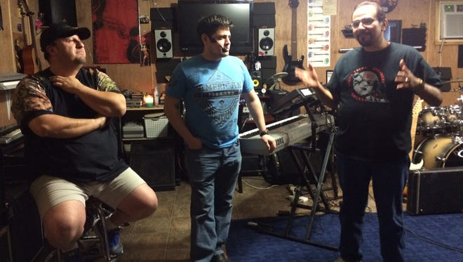 Timeline takes a break during rehearsal. They will perform Saturday at Riley's Pub.