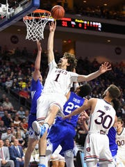 Saint Mary's Gaels center Jordan Hunter (1) shoots the basketball against the BYU Cougars during the first half in the semifinals of the West Coast Conference tournament at Orleans Arena.