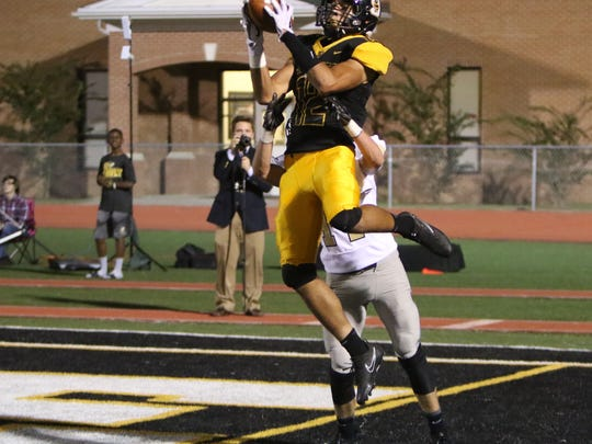 Starkville Yellowjacket wide receiver Cameron Gardner makes the catch for a touchdown against the Northwest Rankin Cougars in Friday night's matchup.