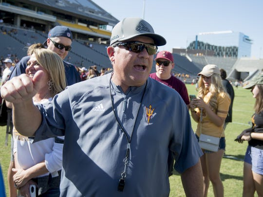 ASU coach Todd Graham waves after the annual spring