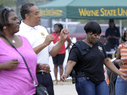 "Wayne County Sheriff Benny Napoleon, second from left, and Deputy Ciara Holt, center, dance to ""The Wobble"" at Field Day and Community Event."