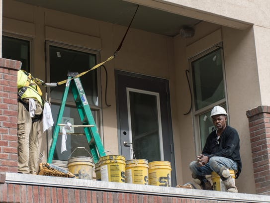 Construction workers continue work on Studer Properties'