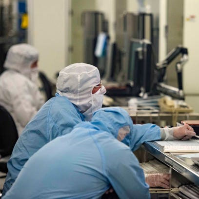 Operators work in a masking room at the GlobalFoundries