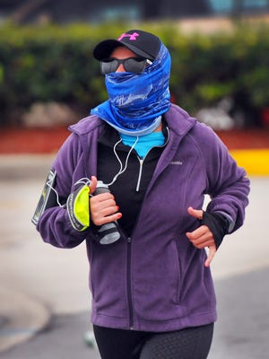 Runners bundled up for cold weather during the 2016 Publix Florida Marathon and Half Marathon in Melbourne.