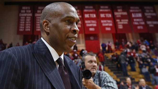 Former Indiana University head basketball coach Mike Davis lost to the Hoosiers 83-64, but still managed a warm smile as he walked off the court at Assembly Hall following his Texas Southern Tigers' 83-64 loss in Bloomington on Monday, Nov. 17, 2014. Davis took over the program after Bobby Knight was fired in September 2000 and left IU after the 2005-06 season.