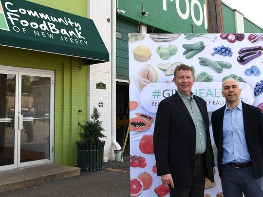 The Community Food Bank of New Jersey headquarters in Hillside, NJ on Friday June 08, 2018. Patrick J. O'Neill the CEO of Amp Your Good and a #GiveHealthy Partner with Riccardo Accolla who organized a food delivery for the Community Food Bank through #GiveHealthy.