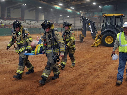 """First Responders carry away a """"victim"""" in a mock gas"""