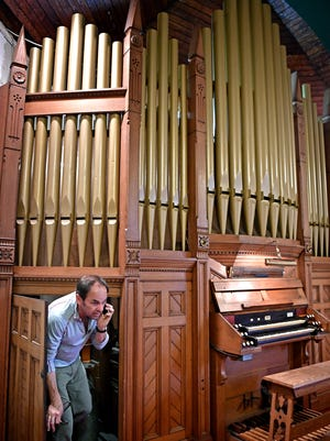 Dan Cook crawls out from behind the inner workings of the organ as he checks it out riday April 28, 2017. The West Nashville United Methodist Church is being developed into an event space and that means its 1905 Kilgen and Son pipe organ needs to find a new home.