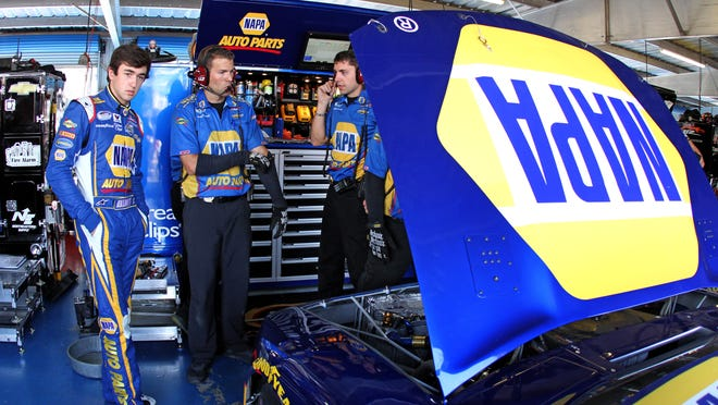 Travis Mack, center, chats with Chase Elliott last May during practice for the Aaron's 312 at the Talladega Superspeedway. Mack, a Louisville native, serves as the Nationwide Series team's car chief.