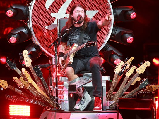 Dave Grohl rocks out with a broken leg atop his custom