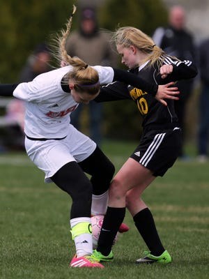 """Ashley Pyle of Appleton East and Brianna Johnson of Green Bay Preble battle for the ball during the second day of the Appleton North varsity girls """"Power of Pink"""" soccer invitational at North on Saturday, April 25, 2015. Six teams played in the invitational with money raised being donated in the fight against breast cancer.Ron Page/Post-Crescent Media"""