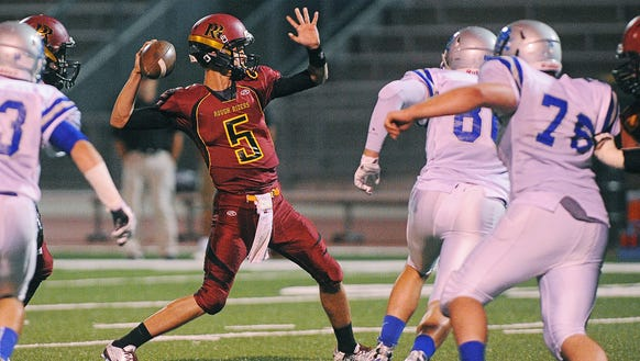 Roosevelt's Jett Thune (5) winds up for a pass during