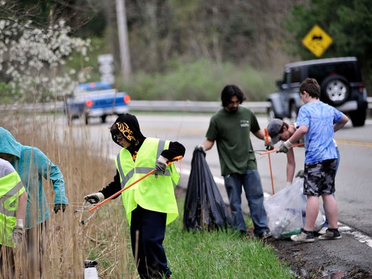 West Milford Councilwoman Marilyn Lichtenberg suggested residents avoid picking up garbage on the county roads, such as Macopin Road where volunteers were spotted in this 2016 photo, until the county stops using herbicides to combat roadside vegetation.