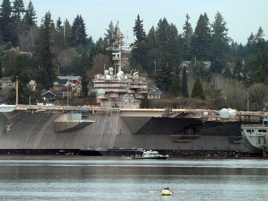 The USS Kitty awk and the Bremerton's mothball fleet of ships as seen from Port Orchard on Thursday.