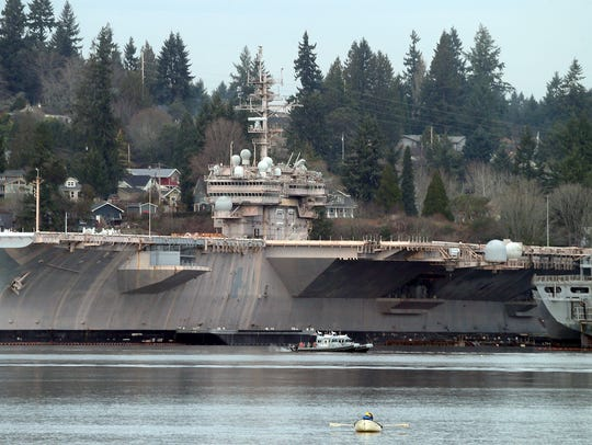 The USS Kitty hawk and the Bremerton's mothball fleet of ships at Naval Base Kitsap-Bremerton from Port Orchard.