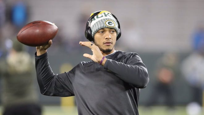 Green Bay Packers quarterback Brett Hundley warms up before their game against the Detroit Lions on Nov. 6, 2017, at Lambeau Field.