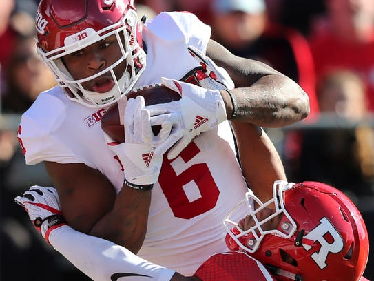 Indiana's Camion Patrick (6) catches a pass for a touchdown