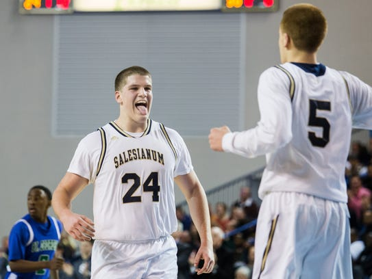 Salesianum's Brian O'Neill reacts as he congratulates teammate Donte DiVincenzo on hitting a three-point shot in the fourth quarter of the Boys State Basketball Championship in 2014.