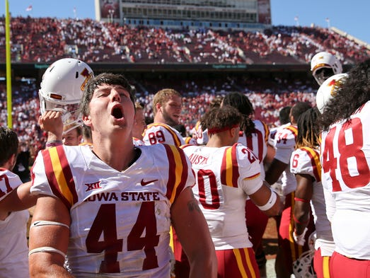 Iowa State linebacker Bobby McMillen III yells in celebration