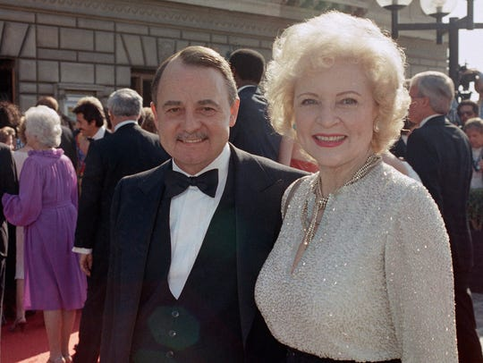 John Hillerman, left, and Betty White, right, arrive