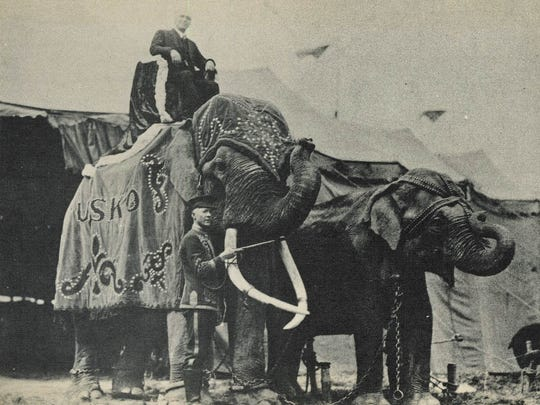 Tusko was the main attraction with the Al G. Barnes Circus in the 1920s. Barnes, the owner of the show, is sitting on top of him in this photo, and handler Red McKay is standing next to him.