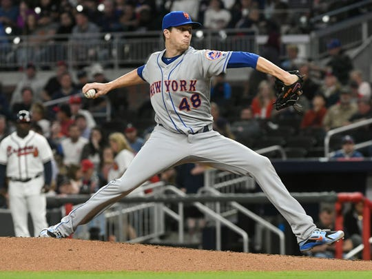 New York Mets' Jacob deGrom pitches against the Atlanta Braves during the fifth inning of a baseball game Saturday, April 21, 2018, in Atlanta.
