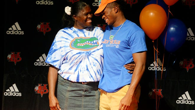 Vero Beach High School linebacker David Reese shares a laugh with his mother, Patricia, Wednesday, Dec. 20, 2017 after signing his letter to play football at the University of Florida at the Performing Arts Center at Vero Beach High School. To see more photos, visit TCPalm.com