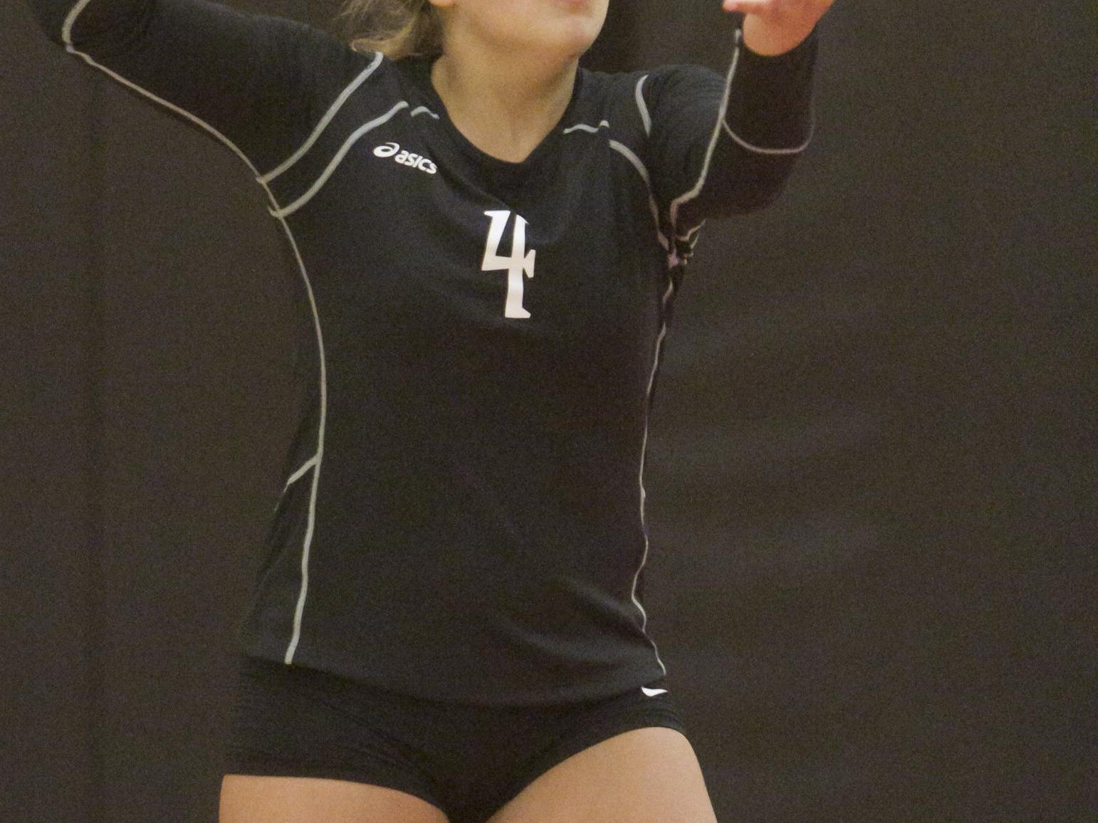 Brighton's Cora Pietila serves in Tuesday's match at Pinckney. She had 10 digs at libero as the Bulldogs stayed unbeaten in the KLAA West.