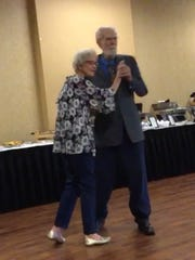 Bobby and Bonnie Barnett dance to a waltz their son,