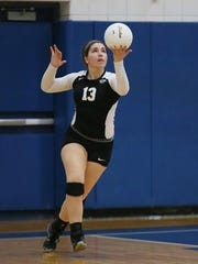 Getting ready to serve during a 2014 game is Plymouth's Daniella Barile.