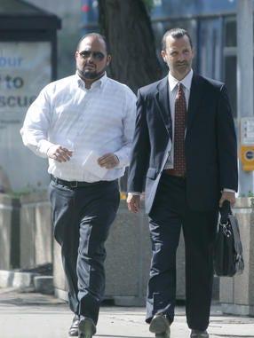 Joseph Ruff walks toward federal court with defense attorney Matt Parinello on July 1 2014.