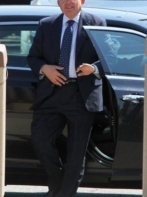 Sen. Robert Menendez walks toward the Federal Courthouse in Newark , NJ to make is first appearance in front of a judge to made a plea federal prosecutors accused him of participating in a bribery scheme with a wealthy donor.