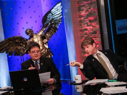 Panelists Bradley Eli, left, and Michael Voris chat
