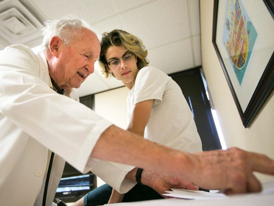 Dr. John Dorsey, nearly 90, shows Jared Pauli, 18,